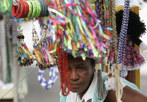 A street vender waits for client in Salvador,bBrazil,in this January 6 file photo.