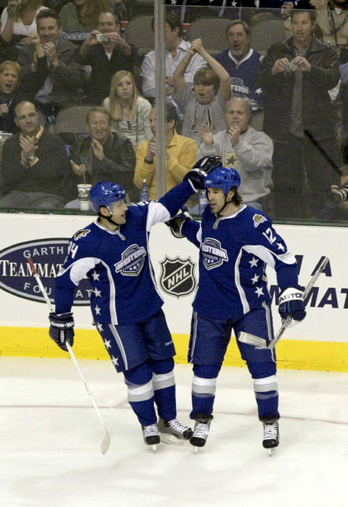 Western Conference players Yanic Perreault, left, and Brian Rolston celebrate Perreault's first goal in the NHL All-Star game in Dallas on Wednesday. ...