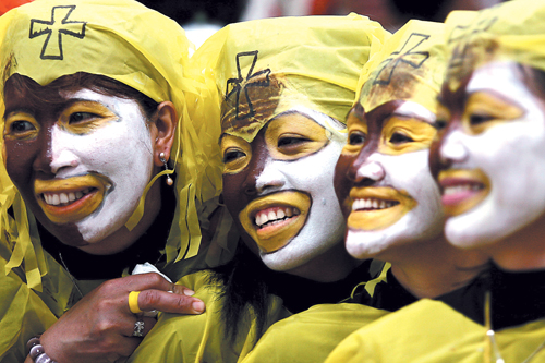 Filipinos wearing colorful make-up and costumes participate at a religious festival in Taipei last Sunday. MECO and DOLE say they are building an onli...