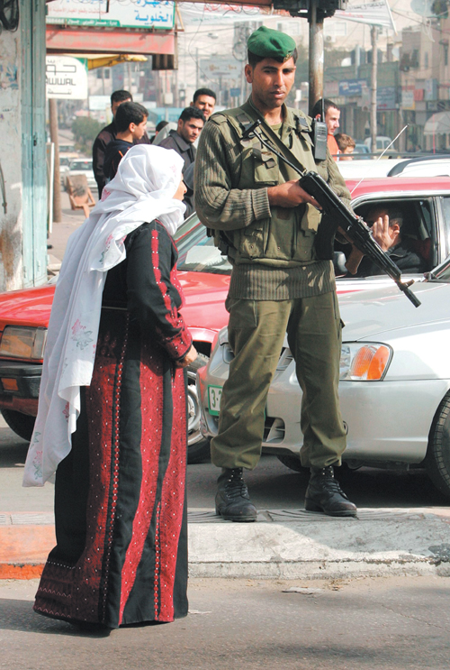 A member of the Palestinian security forces patrols a street in Gaza City, Gaza Strip yesterday.