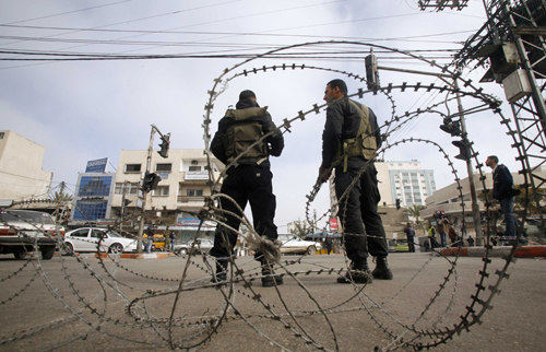 Palestinian security forces loyal to President Mahmoud Abbas stand guard on the closed the main road in Gaza city on Saturday.