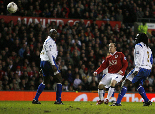 Manchester United's Wayne Rooney, second from right, scores his second goal during an FA Cup fourth round soccer match against Portsmouth in Mancheste...