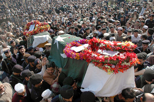 Mourners carry the coffins of senior police officials, victims of Saturdays suicide bombing, during their funeral in Peshawar, Pakistan yesterday.