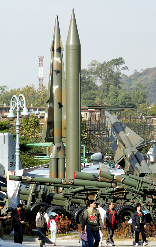 Tourists walk by displays of North Korea's missiles at Korea War Memorial Museum in Seoul, South Korea, in this October, 2006 file photo.