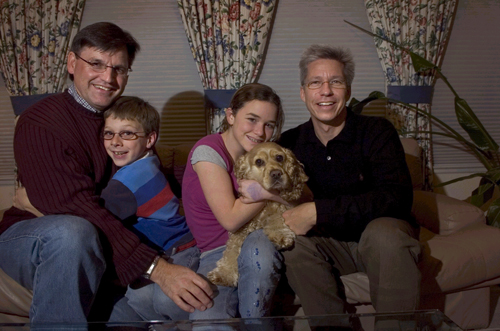 Same-sex parents Ed Condon, left, and Norman Lorenz, right, adopted Tim Condon-Lorenz, 9, and Maddy Condon-Lorenz, 12, holding Sonny, as infants in El...