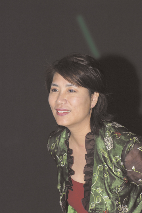 Jeane Huang, editor-in-chief of the English-language arts and living magazine, Fountain, smiles to the camera.