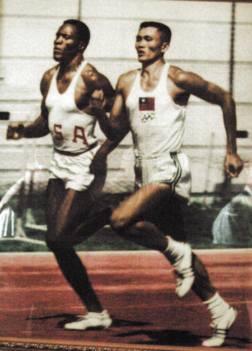 Asian Iron Man Yang Chuan-kwang, Taiwan's first Olympic medalist, is seen training with Olympic gold medalist Rafer Johnson in this undated file photo...