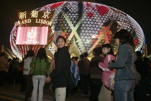 People line up outside the Grand Lisboa casino in Macau on February 11.