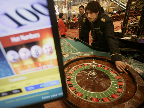 A man plays a roulette wheel at the New Grand Lisboa casino in Macau, on February 11. Macau, one of the fastest-growing economies globally, overtook L...