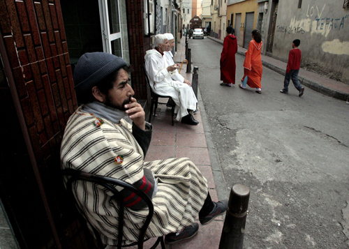 People sit in a street in Spain's North African enclave of Ceuta in this April 20 photo.