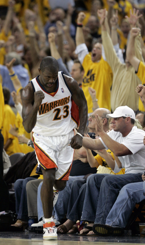 The Golden State Warriors' Jason Richardson is cheered on by yellow-clad fans after he made a basket against the Dallas Mavericks during Game 3 of the...