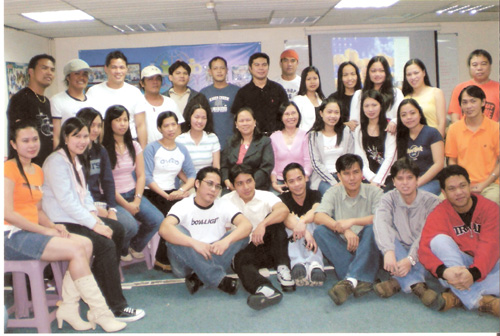 Graduates of MECO-Taichung's free basic computer course share a light moment at MECO's activity center recently.  These migrants have temporarily left...
