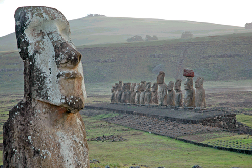 The massive stone sentinels of Ahu Tongariki seem imperious, an uncompromising guard against the gluttonous sea crashing at its flank on Easter Island...