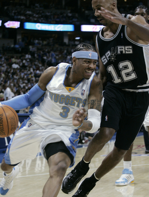 Denver Nuggets guard Allen Iverson, left, works the ball inside for a shot past San Antonio Spurs guard Bruce Bowen in the first quarter of Game 3 of ...