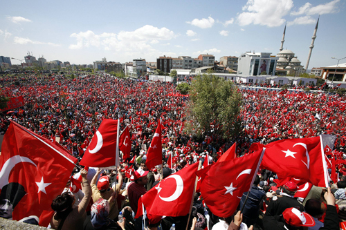 Tens of thousands of Turks wave their national flags to oppose the government's presidential candidate during a rally in Istanbul, Turkey yesterday.