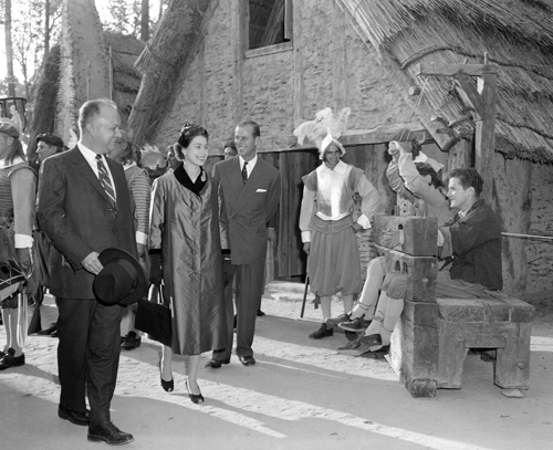 """Queen Elizabeth II and Prince Philip view a couple of """"prisoners"""" in stock at Jamestown, Virginia in this October 16, 1957 photo."""