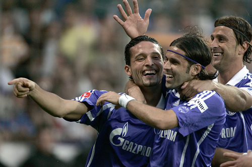 From left, Schalke's Kevin Kuranyi, Lincoln of Brazil and Marcello Bordon celebrate after scoring during their match with VfL Bochum on Friday. Schalk...
