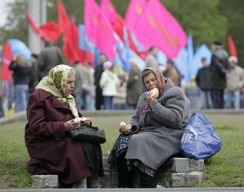 Communist supporters eat their lunch as they attend a traditional May Day demonstration in Kiev, Ukraine yesterday. Thousands of Ukrainians gathered...
