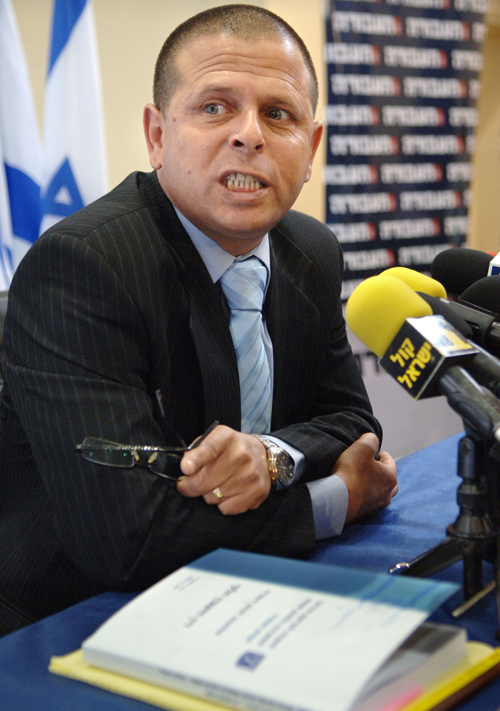 Israeli Cabinet Minister Eitan Cabel speaks at a news conference to announce his resignation in Tel Aviv, Israel yesterday.