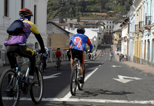 Cyclists ride on the streets in Quito, Ecuador. Every other Sunday streets in the town are closed to automobile traffic so people can ride safely. The...