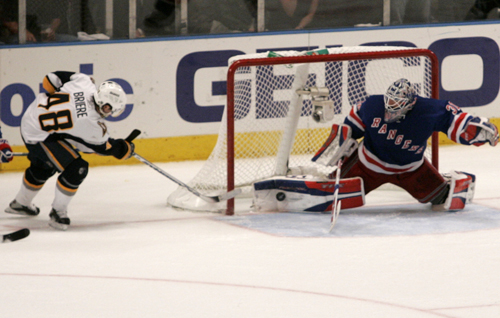 New York Rangers goaltender Henrik Lundqvist, right, makes a pad save on the goal line on a stuff attempt by the Buffalo Sabres' Daniel Briere, left, ...
