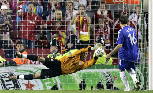 Liverpool goalkeeper Jose Reina saves a penalty kick by Chelsea's Arjen Robben during their Champions League semifinal second leg soccer match at in L...