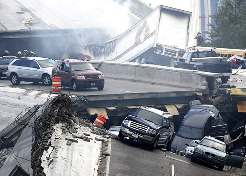 Cars lie in the wreckage of the collapsed I-35W bridge that spans the Mississippi River in Minneapolis, Minnesota on Wednesday.
