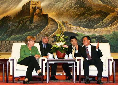 Chairman of the Standing Committee of the National People's Congress Wu Bangguo, right, meets with German Chancellor Angela Merkel in Beijing, China y...