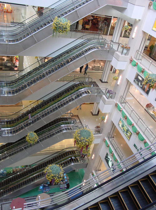 Empty escalators are seen inside the Golden Resources Shopping Mall in western Beijing, China.