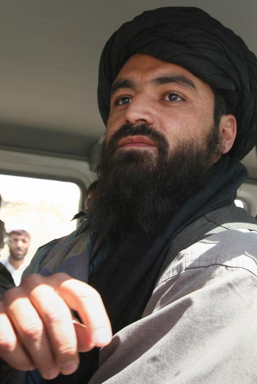 One of the Taliban representatives, Qari Bashir, is seen in the vehicle of the International Committee of the Red Cross heading to the Afghan Red Cres...