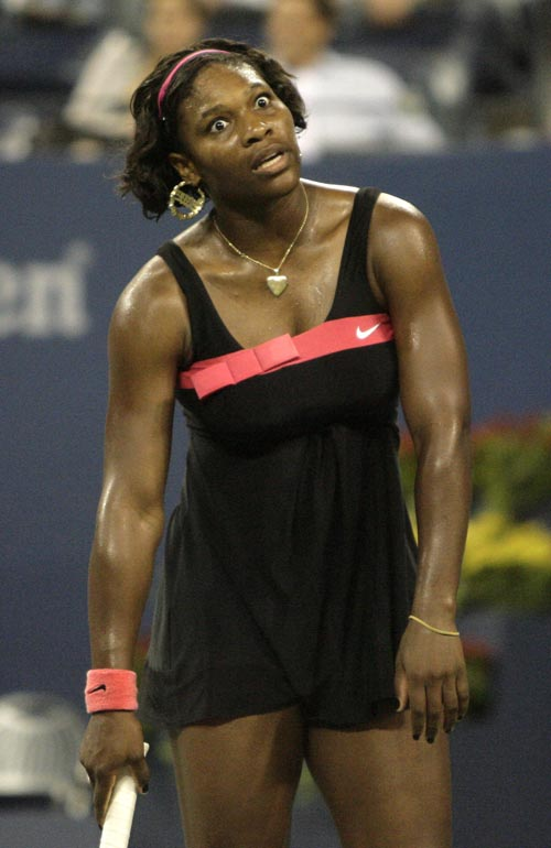 Serena Williams of the United States reacts to a point in her match with Angelique Kerber of Germany during the first round of the US Open tennis tour...