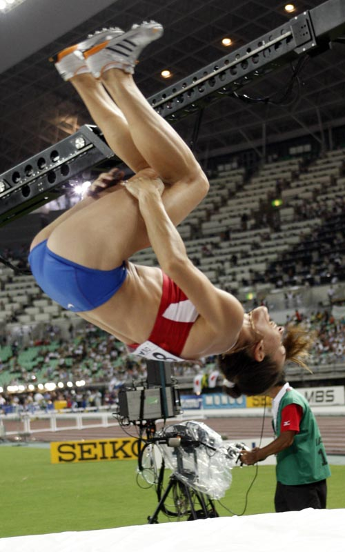 Russia's gold medal winner Yelena Isinbayeva makes a somersault as she celebrates after the women's pole vault final at the World Athletics Championsh...