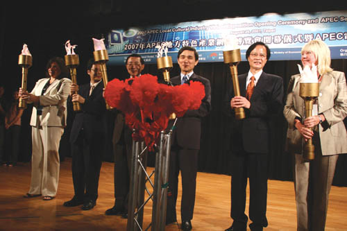 Guests light up torches to begin the opening  ceremony.  From left to right, Madeleine Burns, Ming-Hsin Gong, Yun-Rong Lin, Dr. Yen-Shiang Shih, Yun-...