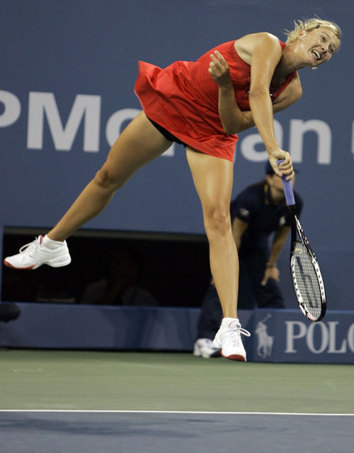 Maria Sharapova of Russia serves to Roberta Vinci of Italy at the US Open tennis tournament in New York on Tuesday.