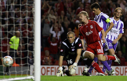 Liverpool's Dirk Kuyt, third from the right, scores the first of his two goals against Toulouse during their Champions League third round qualifying m...