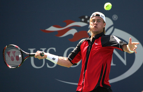 Lleyton Hewitt of Australia returns a ball to Amer Delic during the US Open on Tuesday.