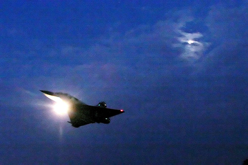 A Mirage 2000 fighter flies in front of the moon before landing at the Songshan Air Force Base in Taipei yesterday.