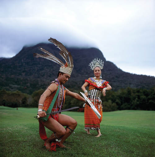 Traditional dancers of Sarawak wear colorful costumes. Sarawak, Malaysia's largest state, has 23 ethnic groups.
