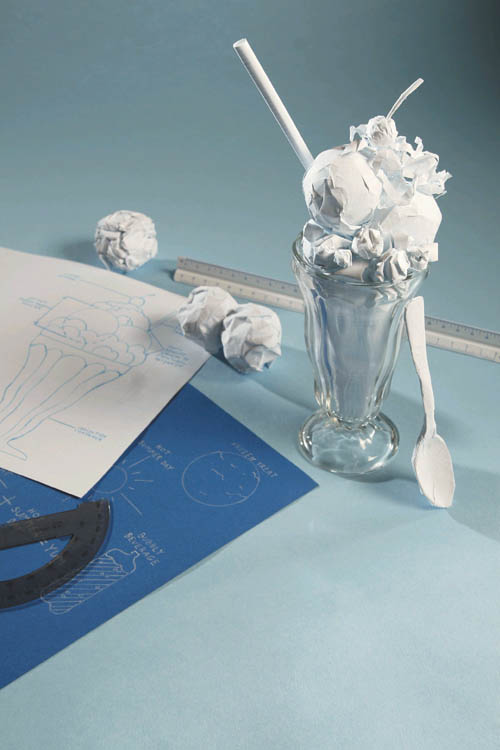 The reinvented ice cream float brings back the image of nostalgic comfort food. Wadded paper is used to plan the design for an ice cream float.