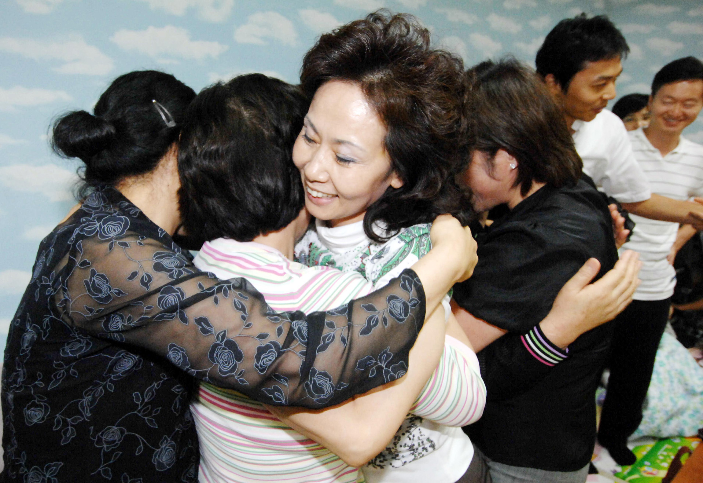 Relatives of South Koreans kidnapped in Afghanistan react as they hear a news report of their release in Sungnam, south of Seoul, South Korea yesterda...