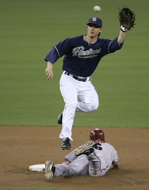 Arizona Diamondbacks' Stephen Drew, bottom, steals second in San Diego, California on Thursday.