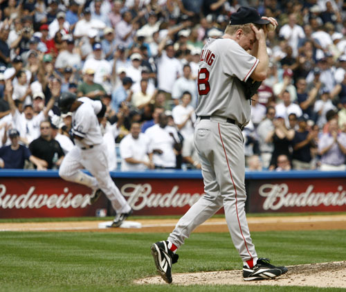 Boston Red Sox starting pitcher Curt Schilling, right, reacts as New York Yankees batter Robinson Cano, left, runs out his second home run of the game...