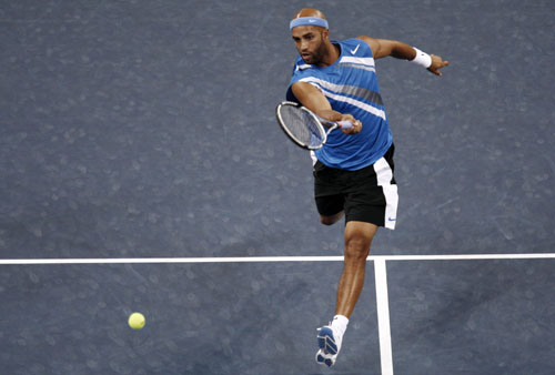 James Blake hits a leaping volley to Fabrice Santoro during their match at the U.S. Open tennis tournament in Flushing Meadows, New York on Thursday....