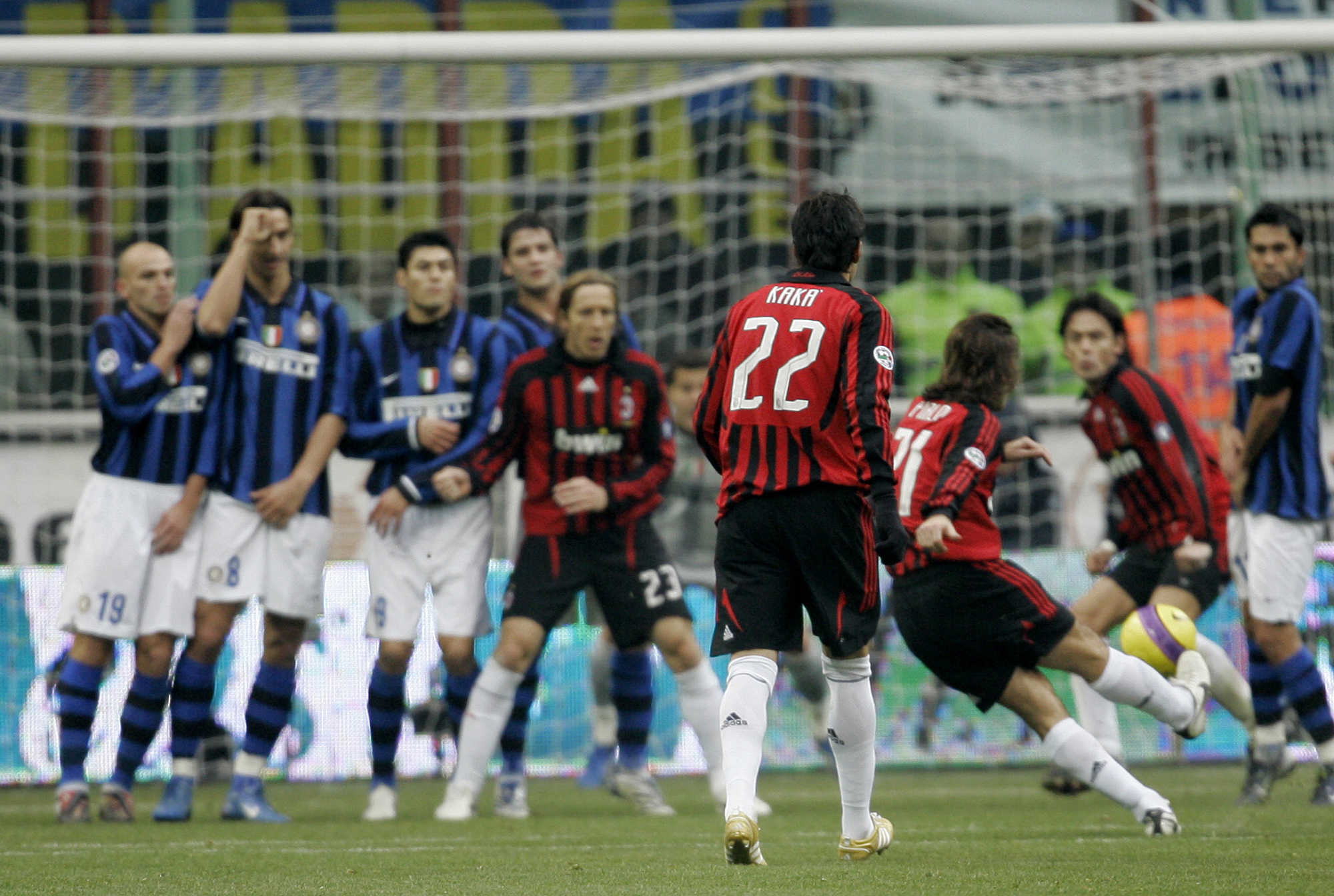 AC Milan midfielder Andrea Pirlo, right, scores from a free kick, during the Italian first division soccer match between Inter Milan and AC Milan at t...
