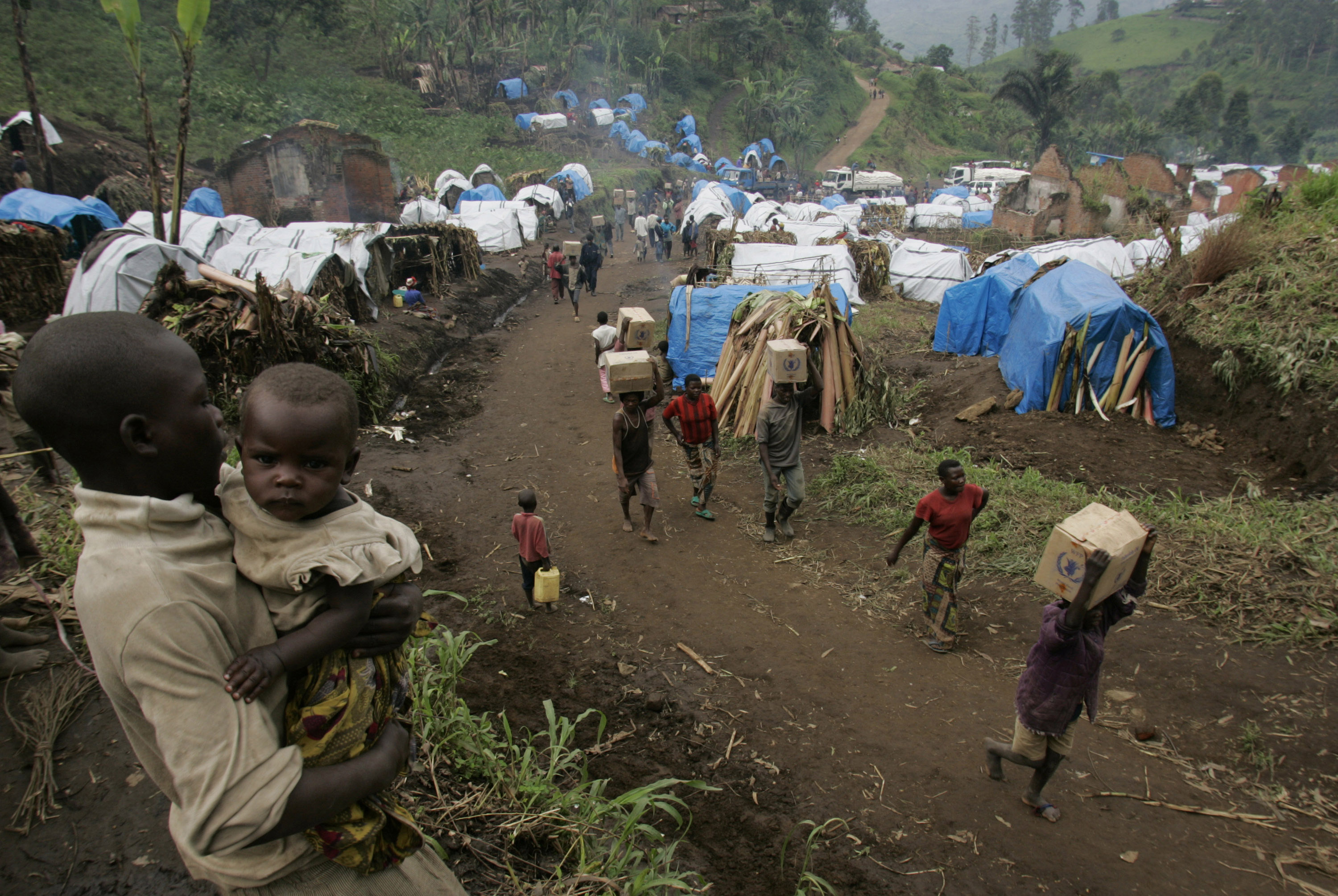A Congolese boy carries his sister at a camp for displaced persons in Masisi, Congo in this November 22 photo.