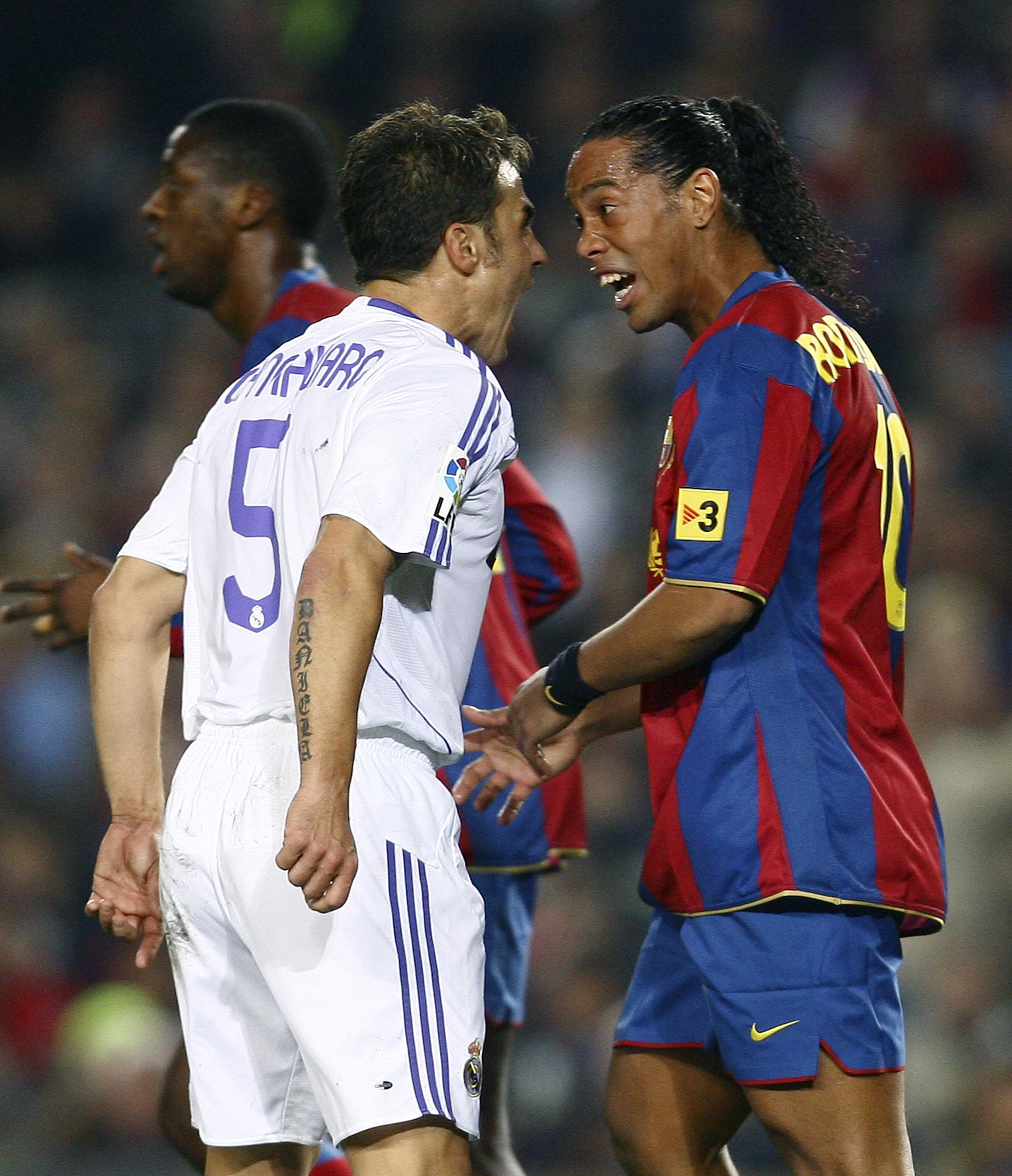 Real Madrid's Fabio Cannavaro, left, argues with Barcelona's Ronaldinho during their match in Barcelona on Sunday.