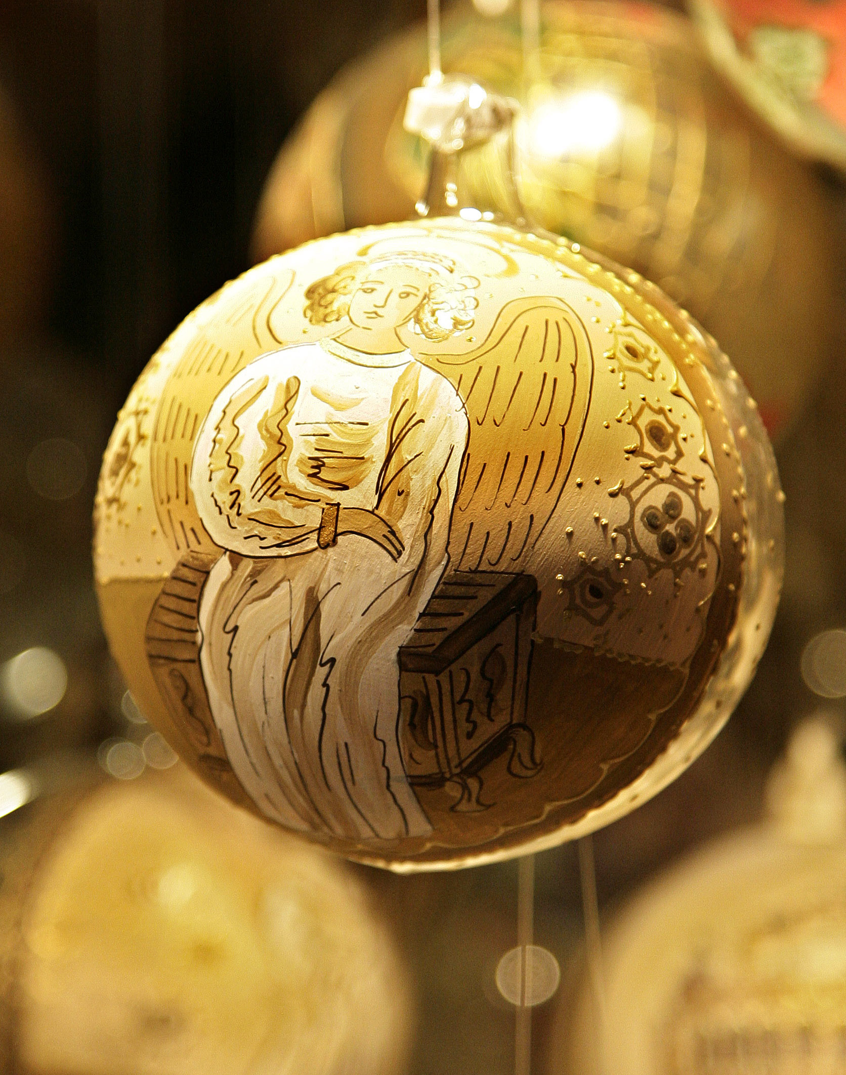 A Christkind painted on a Christmas tree ornament at a stand in Vienna.