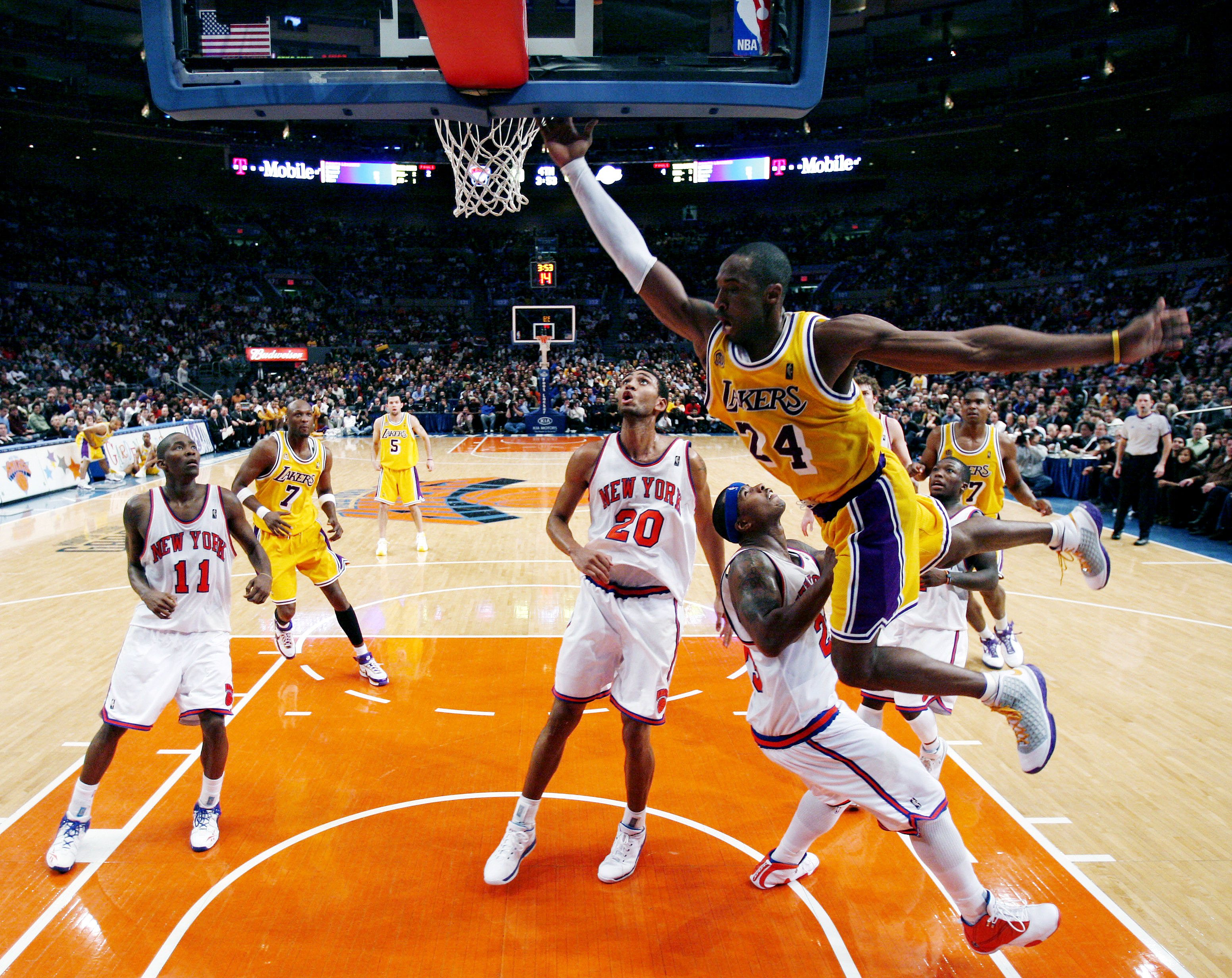 Los Angeles Lakers guard Kobe Bryant (24) drives over New York Knicks guard Quentin Richarson as he tries to score in the fourth quarter of their NBA ...