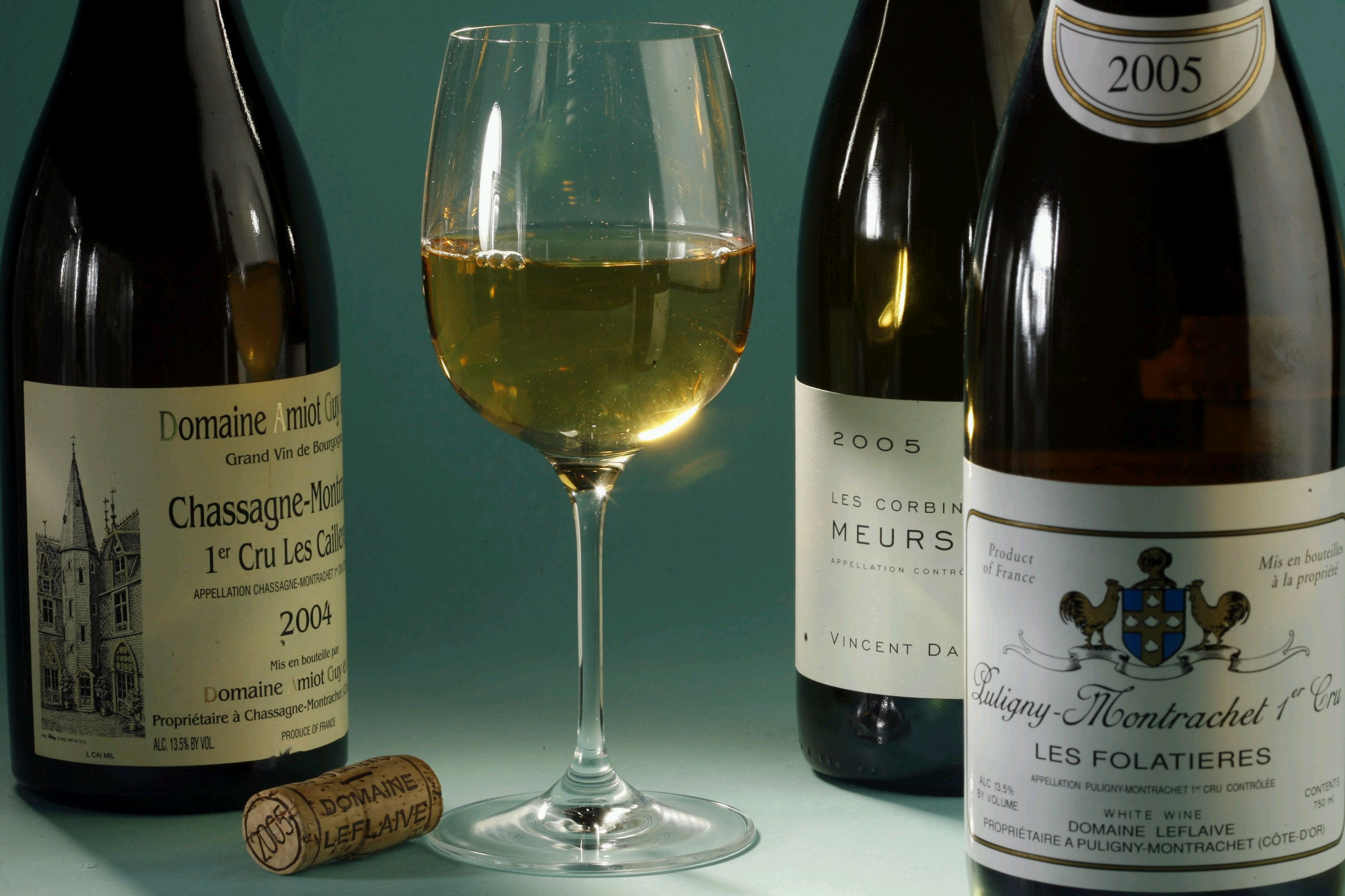 White wines that go well with holiday dinners include, from left, Domaine Amiot Chassagne-Montrachet, Meursault Les Corbins, and Puligny-Montrachet 1e...