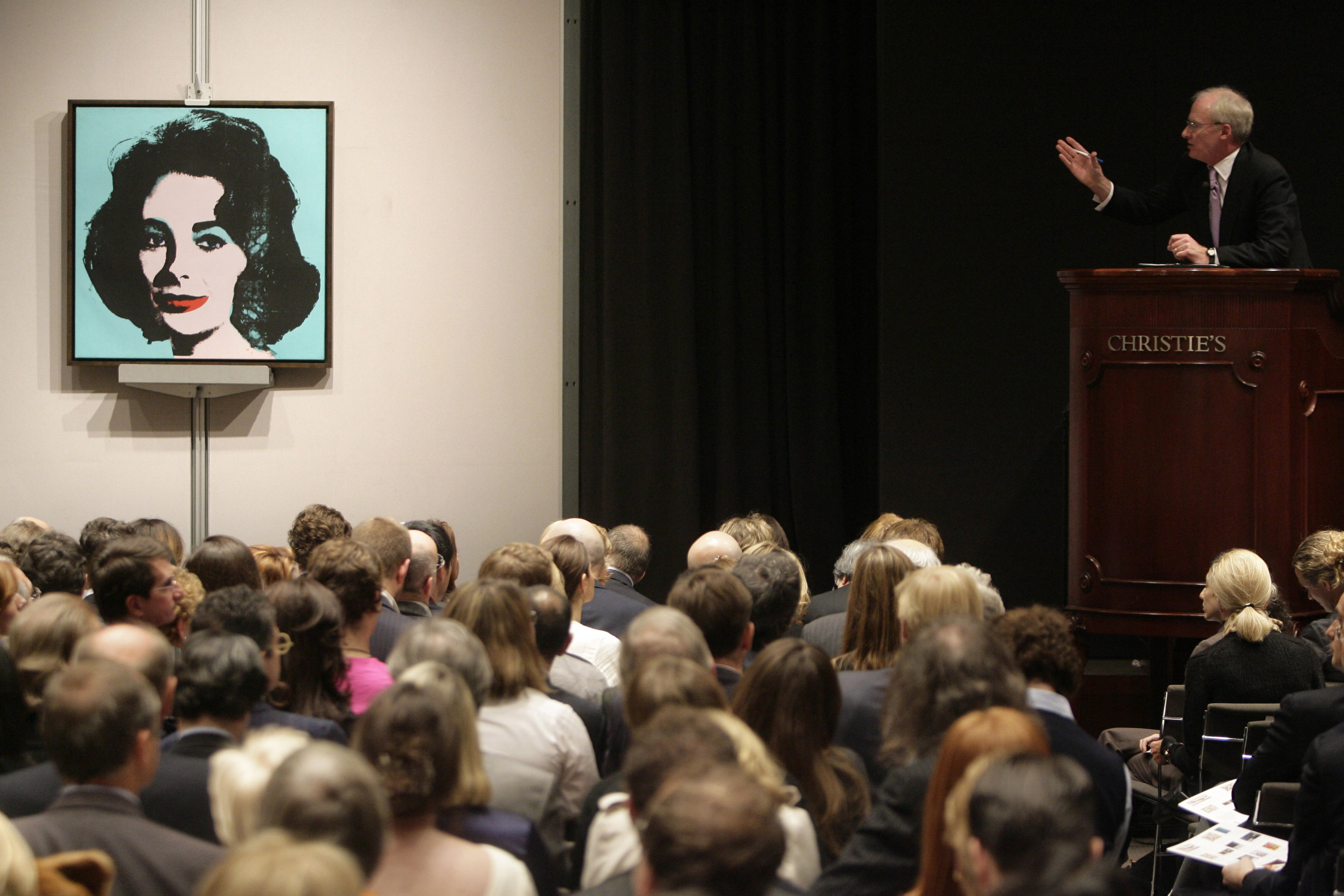 The auctioneer takes bids on Andy Warhol's 'Liz' during the post-war and contemporary art auction at Christie's in New York, on November 13. The Warho...